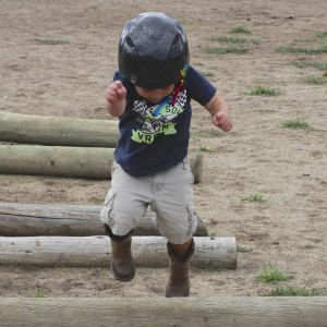 Kid Jumping Over Obstacles